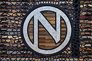 Ninkasi Brewery owners Nikos Ridge (hoodie) and Jamie Floyd in the outdoor courtyard. Ninkasi is a regional craft brewery making beers in the Northwest style. Their location in Eugene, Oregon affords regional access for their primary ingredients, which include: Water, Malt, Hops and Yeast. With the strong regional hop industry, and access to the McKenzie River, source of some of the cleanest water in the world, Ninkasi is well positioned for their goal of brewing high quality craft beers. The beer's namesake, Ninkasi, was the Sumerian goddess of fermentation.