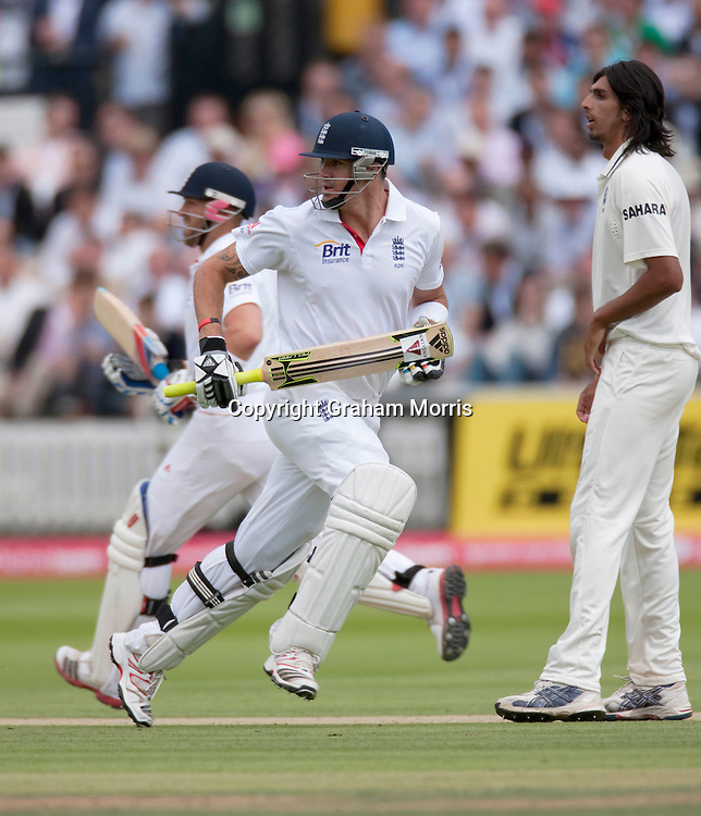 Kevin Pietersen runs (past bowler Ishant Sharma) during the first npower Test Match between England and India at Lord's Cricket Ground, London.  Photo: Graham Morris (Tel: +44(0)20 8969 4192 Email: sales@cricketpix.com) 22/07/11