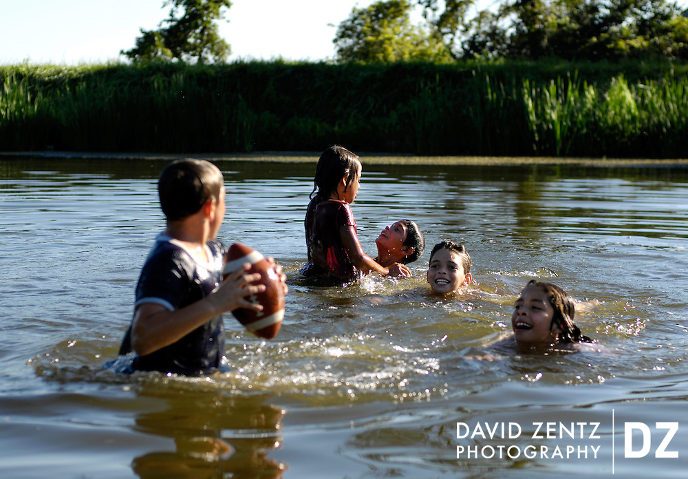 From left, Austin Ventura, 11, Dylan Brown, 9, Harley Dodson, 11, Reyna Ventura, 10, and Addalissa Ventura, 8, all of Spring Valley, splash around in the shallow waters of the Hennepin Canal next to their camp site moments before being told by a park ranger that there is no swimming in the canal due to sanitary concerns.<br /> <br /> Hennepin canal around locks 21 and 20 on Labor Day weekend.<br /> <br /> swimmers/campfire<br /> Diane Brown and Gywan Tanner of Spring Valley camping with their kids and grandkids<br /> Reyna Ventura, 10, in stripes<br /> Addalissa Ventura, 8, in pink<br /> Austin Ventura, 11, in 88 shirt<br /> Harley Dodson, 11, short hair<br /> Dylan Brown, 9, long hair             last two are her kids<br /> The family comes to the canal nearly every weekend to fish and camp.<br /> <br /> Under lock 21<br /> Jason Picatto of Utica with kids Dylan Vizzone, 7, and Hannah Vizzone, 5. Wife is Amanda Picatto and 10-month-old baby is Jason Picatto Jr. <br /> <br /> Fishing lock 20<br /> Rex Klingenberg of Wyanet<br /> left to right along wall is Roxi Klingenberg, Brittney Hutchison, Lisa Vicks (friend) and Kristie Klingenberg (she and Brittney are cousins)<br /> <br /> Camping near bridge<br /> Matt Archer with wife Janice and daughter Nicole of Standard