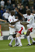 Photo: Marc Atkins.<br />Milton Keynes Dons v Notts County. Coca Cola League 2. 02/09/2006. Lloyd Dyer (L) of MK Dons celebrates with team mates after scoring.