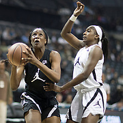 NEW YORK, NEW YORK - April 08:  Queen Egbo #5 Travis H.S. Richmond, TX drives to the basket defended by Elizabeth Balogun #4 Hamilton Heights H.S. Chattanooga, TN during the Jordan Brand Classic, National Girls Teams All-Star basketball game. The Jordan Brand Classic showcases the best male and female high school basketball players who compete in the exhibition games at the The Barclays Center, Brooklyn, New York on April 08, 2018 in New York City. (Photo by Tim Clayton/Corbis via Getty Images)