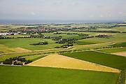 Nederland, Noord-Holland, Wieringen, 14-07-2008; het voormalige eiland Wieringen gezien vanuit de polder Wieringermeer, op Wieringen in de verte de 'hoofdplaats' Hippolytushoef en in de achtergrond de Waddenzee, rechts de Afsluitdijk; het water diagonaal in beeld is het Amstelmeerkanaal, de ringvaart van de polder en het kanaal volgt de rand van het vroegere eiland; er zijn plannen om Wieringen weer een (quasi)eiland te maken door het verbreden van het Amstelmeerkanaal tot een meer (Wieringerrandmeer); de plannen zijn omstreden omdat ze ten koste zullen gaan van landbouwgrond en boeren bedrijven. .luchtfoto (toeslag); aerial photo (additional fee required); .foto Siebe Swart / photo Siebe Swart