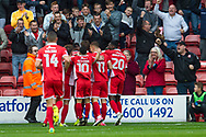 Walsall players celebrate scoring the opening goal during the EFL Sky Bet League 1 match between Walsall and Shrewsbury Town at the Banks's Stadium, Walsall, England on 7 October 2017. Photo by Darren Musgrove.