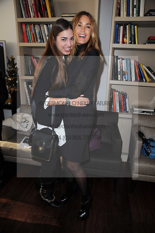 Left to right, AMBER LE BON and YASMIN LE BON at a breakfast hosted by Bobbi Brown - the cosmetics company held at Morton's, 28 Berkeley Square, London on 8th December 2009.
