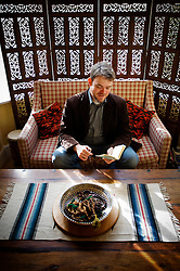 Muslim convert Yahya Birt (son of ex Director General of the BBC, John Birt), reading the Quran, Leicester, England, UK.