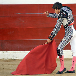 The matador, Pepe Lopez, poised for the kill at a bullfight in Puerto Vallarta, Mexico.