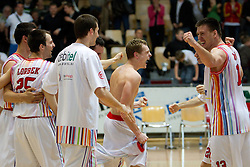 Players of Slovan celebrate after the basketball match between KK Geoplin Slovan and KK Union Olimpija in 4th Round of Telemach Slovenian Champions League, on April 6, 2011, in Sports Arena Kodeljevo, Ljubljana, Slovenia. Geoplin Slovan defeated Union Olimpija 70-69. (Photo by Vid Ponikvar / Sportida)