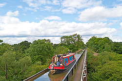 © Licensed to London News Pictures. 20/06/2019. Bearley, Warwickshire, UK. A barge crosses the Edstone Aqueduct during a warm and pleasant day in Warwickshire, UK. At 475 feet (145 m), Edstone is the longest cast iron aqueduct in England Photo credit: LNP