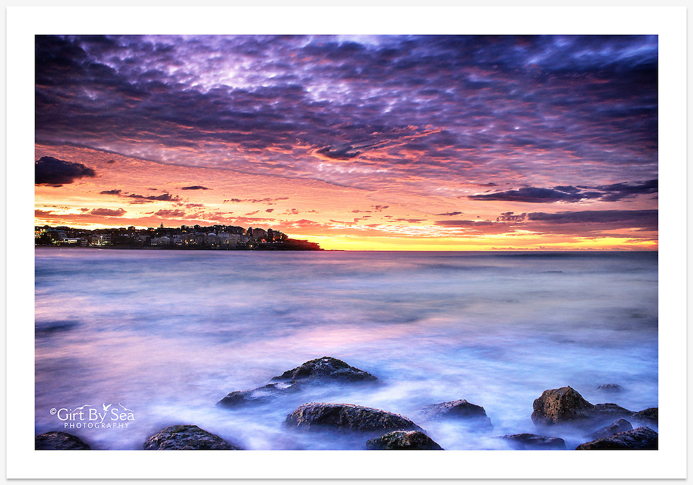 A truly magnificent autumn morning sky captured just before sunrise from the southern corner of Bondi Beach [Bondi, NSW]<br /> <br /> To purchase please email orders@girtbyseaphotography.com quoting the image number PB308331, and your preferred print size. You will receive a quick reply recommending print media options to best suit your chosen image, plus an obligation-free quotation. Current standard size prices are published on the Pricing page.
