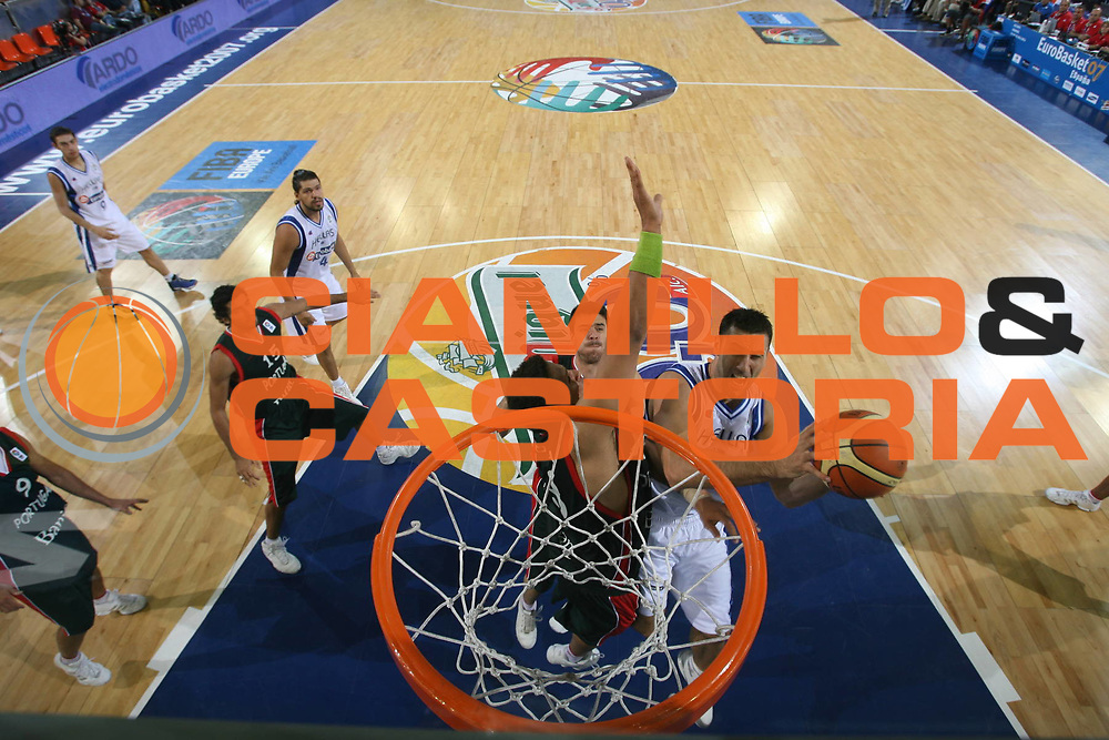 DESCRIZIONE : Madrid Spagna Spain Eurobasket Men 2007 Qualifying Round Grecia Portogallo Greece Portugal <br /> GIOCATORE : Dimosthenis Ntikoudis <br /> SQUADRA : Grecia Greece <br /> EVENTO : Eurobasket Men 2007 Campionati Europei Uomini 2007 <br /> GARA : Grecia Portogallo Greece Portugal <br /> DATA : 11/09/2007 <br /> CATEGORIA : Special San Miguel <br /> SPORT : Pallacanestro <br /> AUTORE : Ciamillo&amp;Castoria/T.Wiedensohler <br /> Galleria : Eurobasket Men 2007 <br /> Fotonotizia : Madrid Spagna Spain Eurobasket Men 2007 Qualifying Round Grecia Portogallo Greece Portugal <br /> Predefinita :