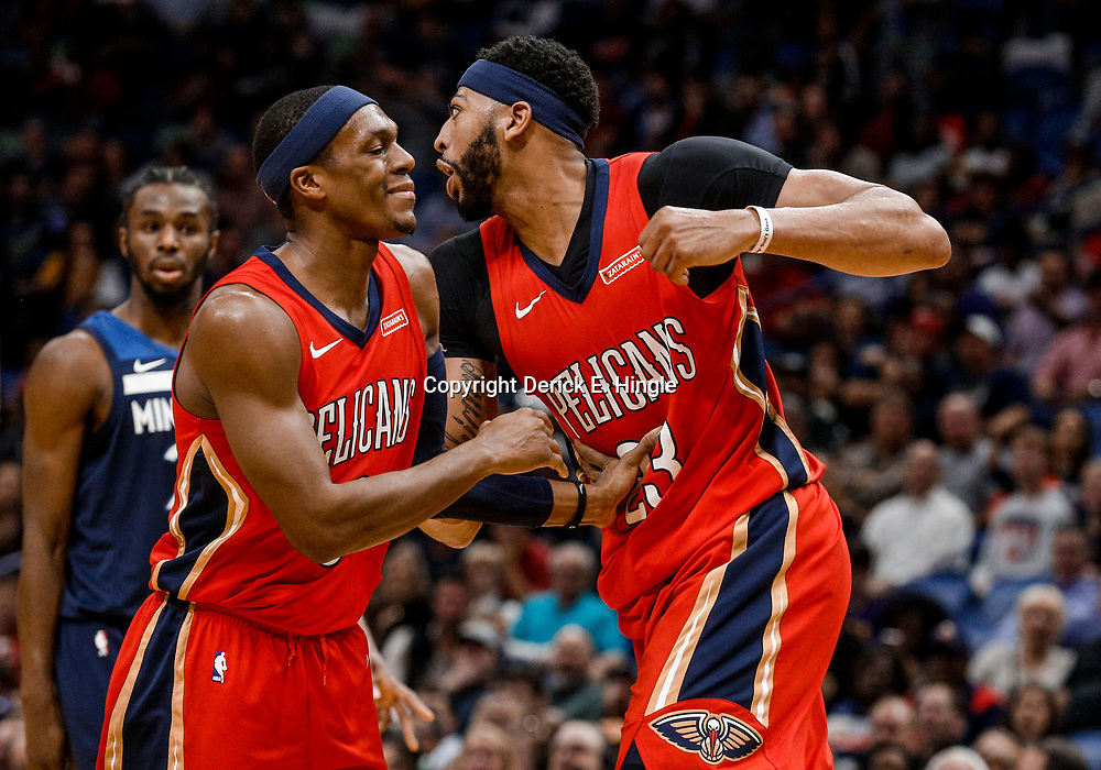 Nov 29, 2017; New Orleans, LA, USA; New Orleans Pelicans forward Anthony Davis (23) is held back by guard Rajon Rondo (9) after being called for a foul during the second quarter of a game against the Minnesota Timberwolves at the Smoothie King Center. Mandatory Credit: Derick E. Hingle-USA TODAY Sports