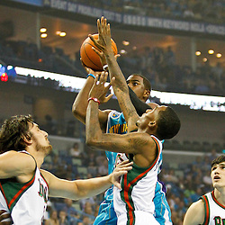 October 27, 2010; New Orleans, LA, USA;  New Orleans Hornets point guard Chris Paul (3) shoots over Milwaukee Bucks point guard Brandon Jennings (3) and center Andrew Bogut (6) of Australia during the first quarter at the New Orleans Arena. Mandatory Credit: Derick E. Hingle