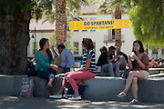 Students socialize outside the new Student Union West Wing during the first day of classes at San Jose State University in San Jose, California, on August 25, 2014. (Stan Olszewski/SOSKIphoto)