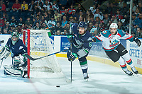 KELOWNA, CANADA - APRIL 26: Carsen Twarynski #18 of the Kelowna Rockets stick checks Jarret Tyszka #5 from behind the net of Carl Stankowski #1 of the Seattle Thunderbirds on April 26, 2017 at Prospera Place in Kelowna, British Columbia, Canada.  (Photo by Marissa Baecker/Shoot the Breeze)  *** Local Caption ***