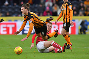 Bristol City striker Cauley Woodrow (18) brings down Hull City midfielder Jackson Irvine (4)  during the EFL Sky Bet Championship match between Hull City and Bristol City at the KCOM Stadium, Kingston upon Hull, England on 25 November 2017. Photo by Ian Lyall.