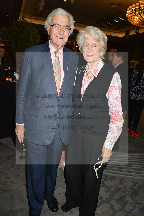 LORD & LADY BAKER OF DORKING at a party to celebrate the publication of Thenford: The Creation of an English Garden by Michael & Anne Heseltine held at The Grosvenor House Hotel, Park Lane, London on 24th October 2016.