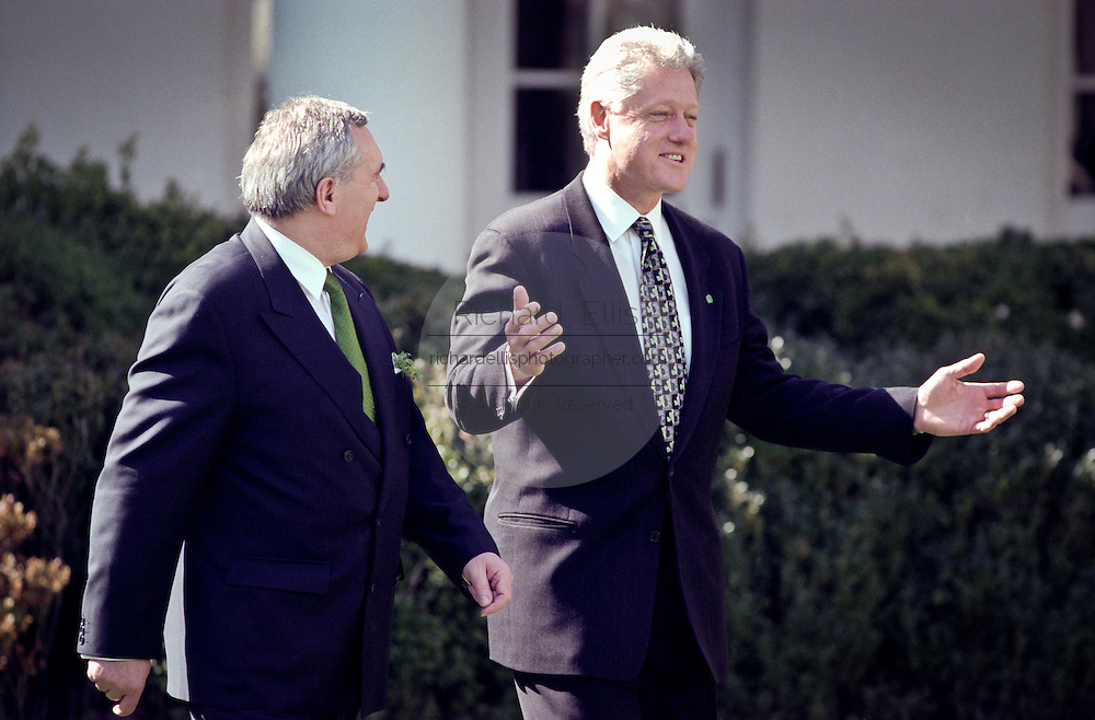 President Bill Clinton walks through the Rose Garden with Irish Prime Minister Bertie Ahern March 17, 1999 before a a St. Patrick's Day event.