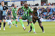 Tom Elliott forward for AFC Wimbledon (9) and Wycombe Wanderers defender Aaron Pierre (6) battle for the ball during the Sky Bet League 2 match between Wycombe Wanderers and AFC Wimbledon at Adams Park, High Wycombe, England on 2 April 2016. Photo by Stuart Butcher.