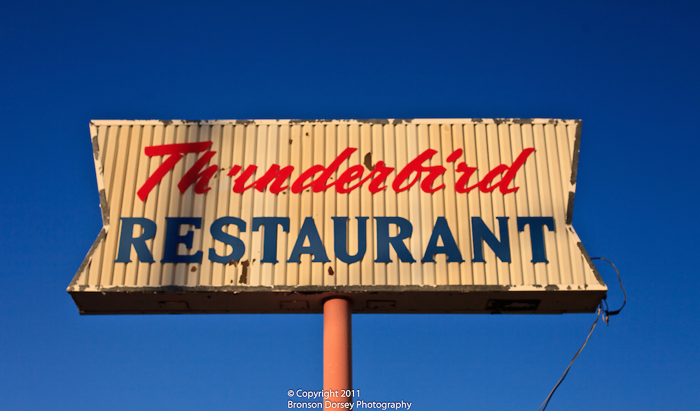 All that remains of the Thunderbird Restaurant in Marfa, TX is a sign with peeling paint.