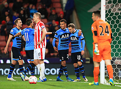 Dele Alli of Tottenham Hotspur celebrates after scoring his sides fourth goal amongst dejected Stoke players  - Mandatory by-line: Matt McNulty/JMP - 18/04/2016 - FOOTBALL - Britannia Stadium - Stoke, England - Stoke City v Tottenham Hotspur - Barclays Premier League