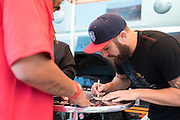 HOUSTON, TX - OCTOBER 3:  Michael Chiesa signs an autograph during the UFC 192 fan village at the Toyota Center on October 3, 2015 in Houston, Texas. (Photo by Cooper Neill/Zuffa LLC/Zuffa LLC via Getty Images) *** Local Caption *** Michael Chiesa