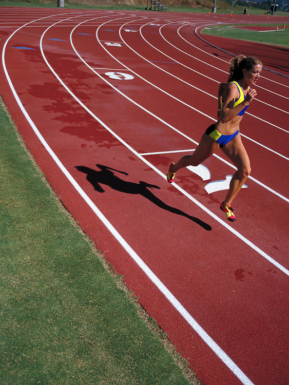 Young woman sprints on track