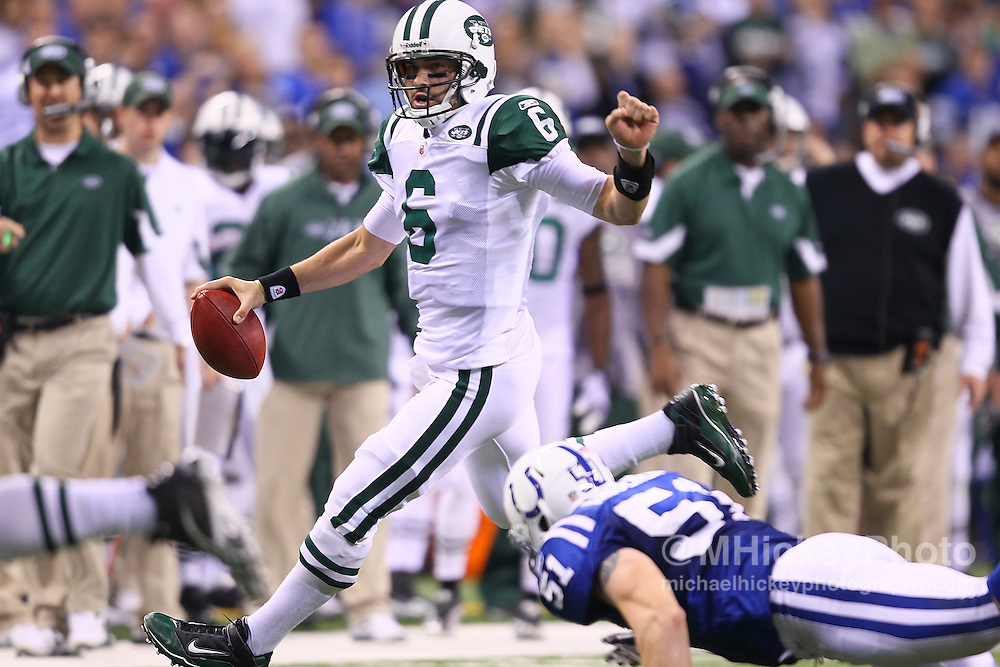 Jan. 08, 2011; Indianapolis, IN, USA; New York Jets quarterback Mark Sanchez (6) scrambles with the ball against the Indianapolis Colts during the 2011 AFC wild card playoff at Lucas Oil Stadium. Mandatory credit: Michael Hickey-US PRESSWIRE