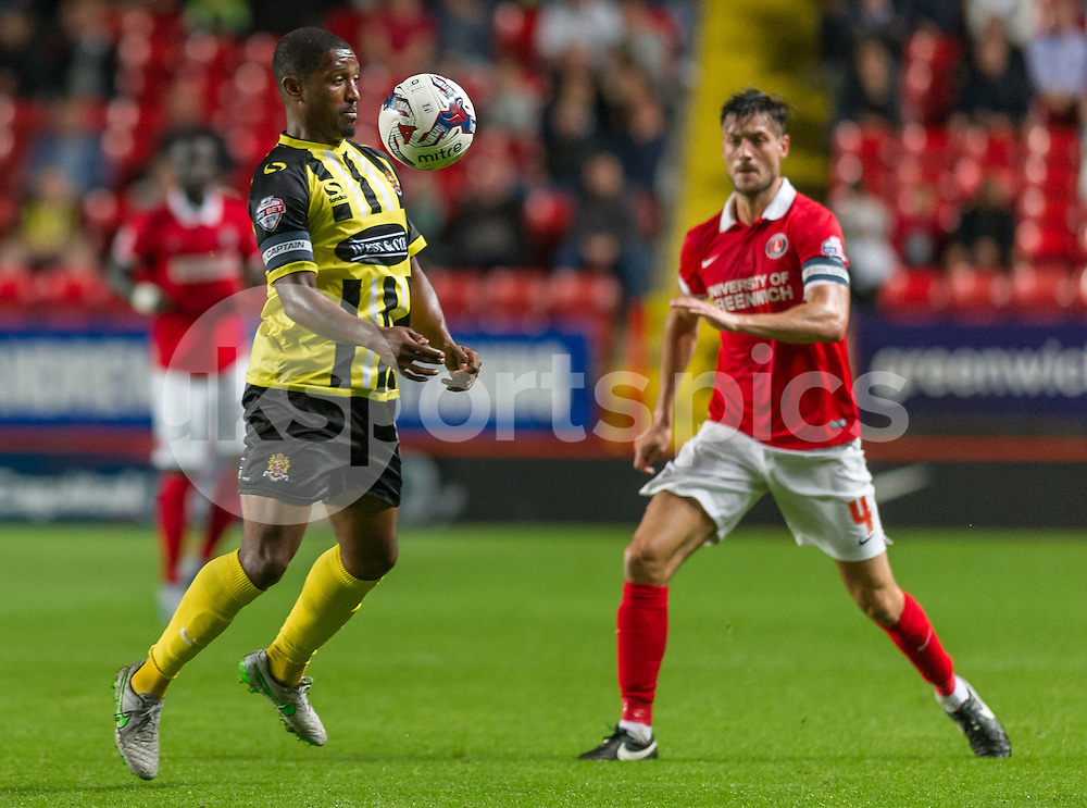 Andre Boucaud of Dagenham & Redbridge and Johnnie Jackson of Charlton Athletic in action during the Capital One Cup match between Charlton Athletic and Dagenham and Redbridge at The Valley, London, England on 11 August 2015. Photo by Vince  Mignott.