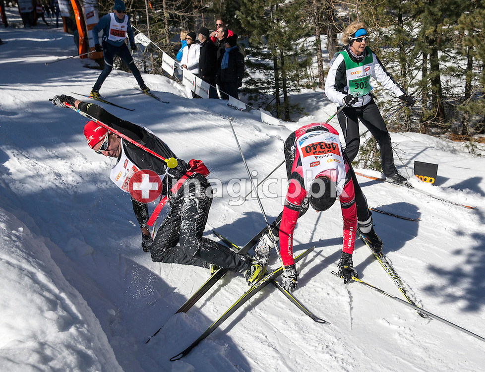Two participants tumble by a downhill in the Stazerwald near St. Moritz, during the annual Engadine cross-country skiing marathon from Maloja to S-Chanf in south Eastern Switzerland, Sunday,  March 10, 2013. Around 12'500 sportsmen and -women participated in the event. (Photo by Patrick B. Kraemer / MAGICPBK)