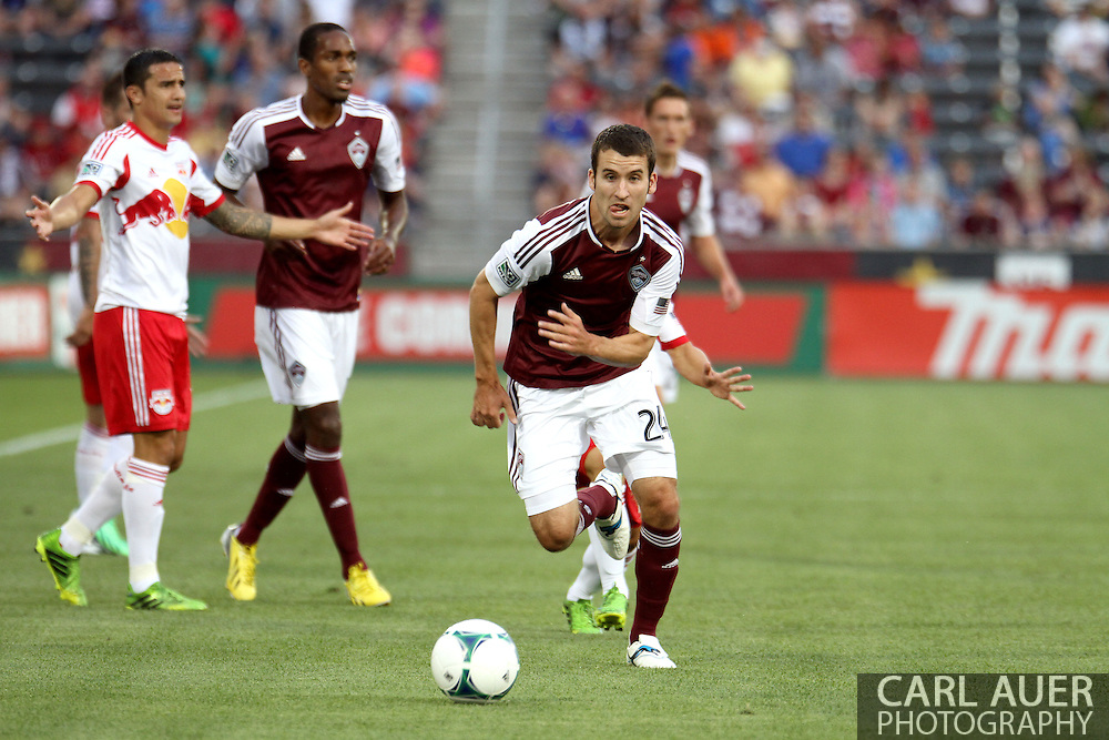 July 4th, 2013 - Colorado Rapids midfielder Nathan Sturgis (24) chases after the ball in the first half of action in the Major League Soccer match between New York Red Bulls and the Colorado Rapids at Dick's Sporting Goods Park in Commerce City, CO