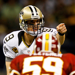 September 9, 2012; New Orleans, LA, USA; New Orleans Saints quarterback Drew Brees (9) signals from the line against the Washington Redskins during the first half of a game at the Mercedes-Benz Superdome. Mandatory Credit: Derick E. Hingle-US PRESSWIRE