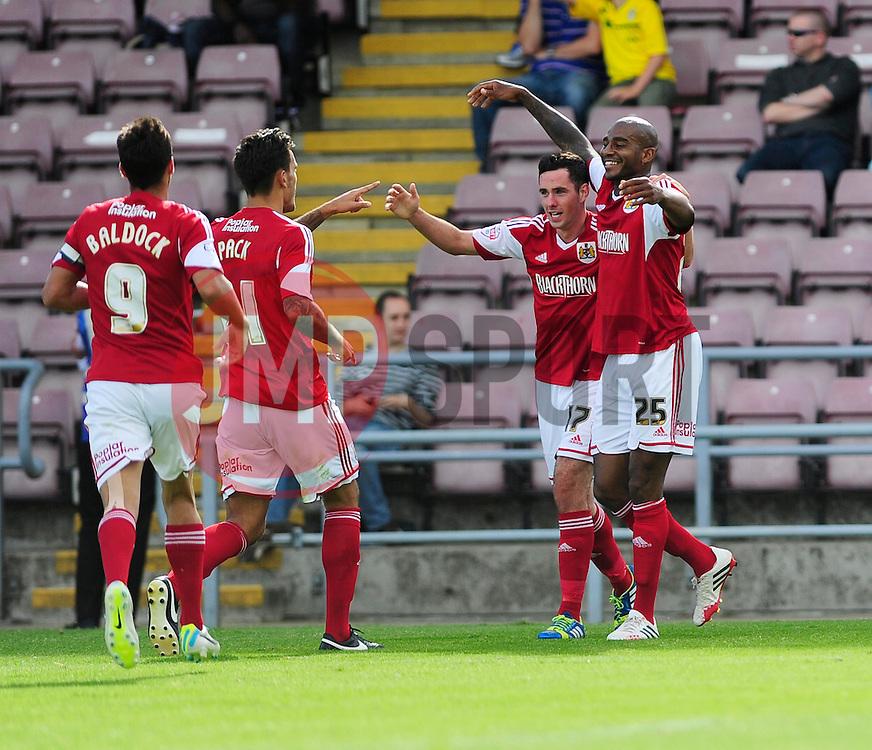 Bristol City's Marvin Elliott celebrates with his team mates after scoring. - Photo mandatory by-line: Dougie Allward/JMP - Tel: Mobile: 07966 386802 11/08/2013 - SPORT - FOOTBALL - Sixfields Stadium - Sixfields Stadium -  Coventry V Bristol City - Sky Bet League One