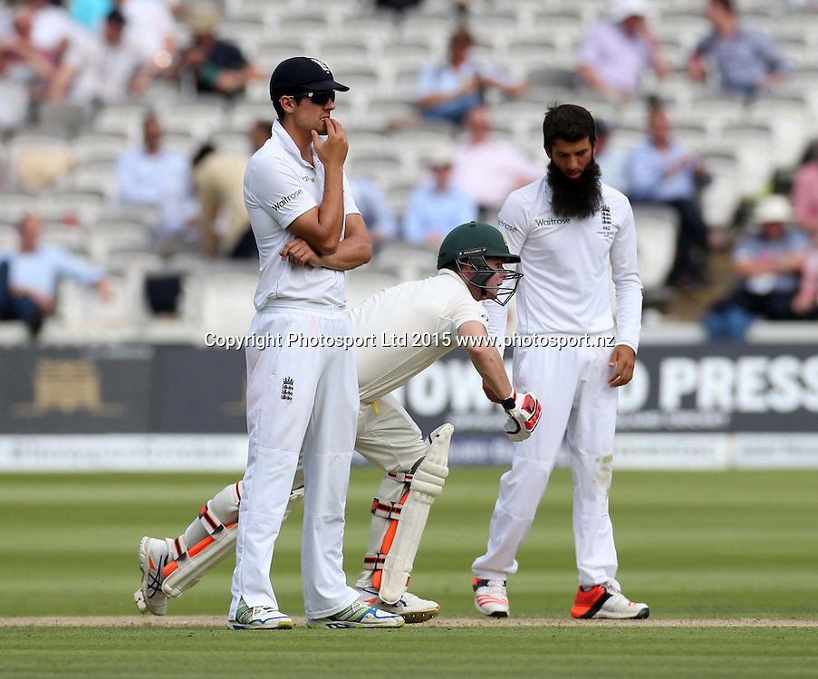 Captain Alastair Cook (left) and bowler Moeen Ali watch runs flow during the second Investec Ashes Test Match between England and Australia at Lord's Cricket Ground, London. Photo: Graham Morris/www.cricketpix.com (Tel: +44 (0)20 8969 4192; Email: graham@cricketpix.com) 16072015