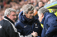 Steve Bruce Manager (left) of Hull City greets Manuel Pellegrini manager of Manchester City and former team mate Brain Kidd during the Barclays Premier League match at the KC Stadium, Kingston upon Hull<br /> Picture by Richard Gould/Focus Images Ltd +44 7855 403186<br /> 15/03/2014