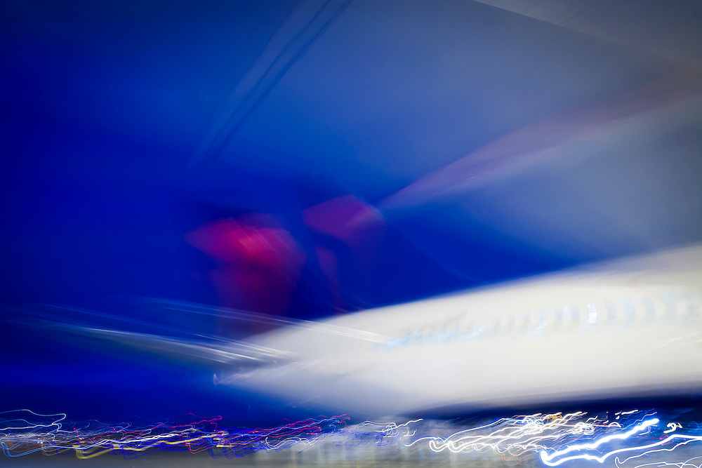 A 4 second exposure rendered this Delta Air Lines Boeing 767-332(ER)(WL) as an abstract study of light and shape, at Atlanta's Hartsfield-Jackson International Airport.