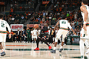 January 24, 2018: Deng Adel #22 of Louisville in action during the NCAA basketball game between the Miami Hurricanes and the Louisville Cardinals in Coral Gables, Florida. The 'Canes defeated the Cardinals 78-75.