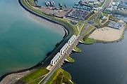 Nederland, Friesland, Groningen, Lauwersoog, 04-11-2018; Lauwersmeer op de grens van Groningen en Friesland, afsluitdijk van de Lauwerszee. In de dijk spuisluizen naar Waddenzee, de R.J. Cleveringsluizen. Naast deze sluizen de schutsluis, de Robbengatsluis.<br /> Lauwersmeer on the border between Groningen and Friesland, the dike of the Lauwers sea.<br /> luchtfoto (toeslag op standaard tarieven);<br /> aerial photo (additional fee required);<br /> copyright &copy; foto/photo Siebe Swart