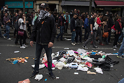 September 15, 2016 - Paris, France - A young man stands next to a pile of trash during protests in Paris on September 15, 2016 . Parisians took out the streets this Thursday to make a new demonstration over the so controversial Labor Law reform in France. Thousands gathered at Place de la Bastille for a peaceful walk to Place de la République, but as is usual, an anarchist group clashed in a confrontation with police that lasted all the way. (Credit Image: © David Cordova/NurPhoto via ZUMA Press)