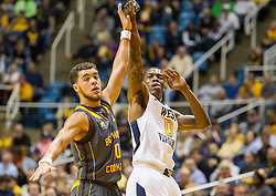 Nov 23, 2015; Morgantown, WV, USA; West Virginia Mountaineers guard Teyvon Myers shoots a three pointer during the first half against the Bethune-Cookman Wildcats at WVU Coliseum. Mandatory Credit: Ben Queen-USA TODAY Sports