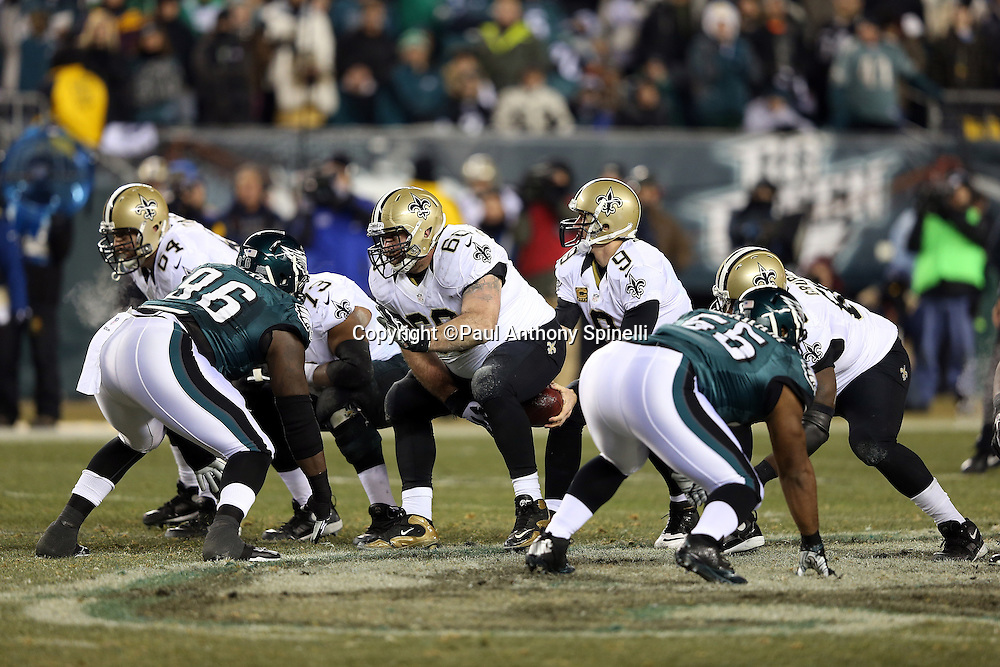 New Orleans Saints center Brian de la Puente (60) snaps the ball during the NFL NFC Wild Card football game against the Philadelphia Eagles on Saturday, Jan. 4, 2014 in Philadelphia. The Saints won the game 26-24. ©Paul Anthony Spinelli