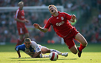 Photo: Paul Thomas.<br /> Liverpool v Blackburn Rovers. The Barclays Premiership. 14/10/2006.<br /> <br /> John Arne Riise (R) of Liverpool is fouled by David Bentley.