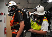 Mining engineering students, Bill Duy, (left), and Joseph McNaughton, suit up in rescue equipment during training at the San Xavier Mining Laboratory Training Center, University of Arizona, Tucson, USA.