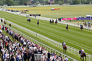The crowds are still packed into The Knavesmire as the horses go down to the start for the last race at the York Dante Meeting at York Racecourse, York, United Kingdom on 18 May 2018. Picture by Mick Atkins.