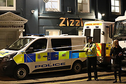 © Licensed to London News Pictures. 06/03/2018. Salisbury, UK. Police in forensics suits and gas masks are seen inside Zizzi's restaurant in Salisbury, Wiltshire, where former Russian spy Sergei Skripal and his daughter visited before becoming ill with suspected poisoning. The couple where found unconscious on bench in Salisbury shopping centre. Specialist units have been called in to deal with any possible contamination. Photo credit: Peter Macdiarmid/LNP