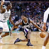 30 January 2013: Sacramento Kings point guard Aaron Brooks (3) drives past Boston Celtics power forward Brandon Bass (30) during the Boston Celtics 99-81 victory over the Sacramento Kings at the TD Garden, Boston, Massachusetts, USA.