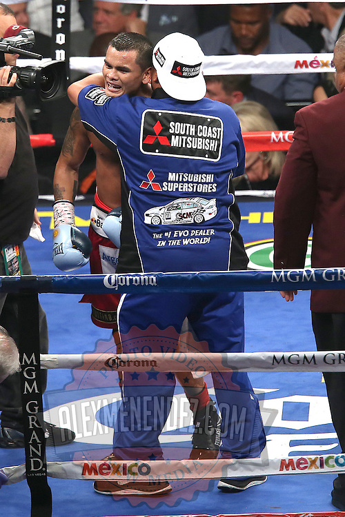 LAS VEGAS, NV - SEPTEMBER 13: (L-R) Trainer Robert Garcia hugs Marcos Maidana after his WBC/WBA welterweight title fight against Floyd Mayweather Jr. at the MGM Grand Garden Arena on September 13, 2014 in Las Vegas, Nevada. (Photo by Alex Menendez/Getty Images) *** Local Caption *** Floyd Mayweather Jr; Marcos Maidana; Robert Garcia