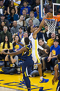Golden State Warriors guard Patrick McCaw (0) dunks the ball over Utah Jazz center Ekpe Udoh (33) at Oracle Arena in Oakland, Calif., on December 27, 2017. (Stan Olszewski/Special to S.F. Examiner)