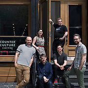 May 1, 2014 - New York, NY : New York hasn't just emerged as a serious coffee town, the city is now teeming with great coffee. Counter Culture Coffee not only sources, roasts, and delivers coffee from around the world; it runs regional training centers, which are dedicated to education and community engagement. Pictured here, members of the Counter Culture crew including, clockwise from left, J. Park Brannen, Katie Carguilo, Erin McCarthy,Ryan Ludwig, Tommy Gallagher, and  Jesse Kahn, pose for a portrait in front of their Broome Street training center on Thursday afternoon. ***Erin Meister is not pictured** CREDIT: Karsten Moran for The New York Times