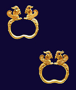 Gold griffin-headed armlet from the Oxus treasureAchaemenid Persian, 5th-4th century BC. From the region of Takht-i Kuwad, Tadjikistan. This gold bracelet is part of the Oxus treasure, the most important collection of gold and silver to have survived from the Achaemenid period. There is a companion piece in the Victoria and Albert Museum. The bracelets are similar to objects being brought as tribute on reliefs at the Persian centre of Persepolis.