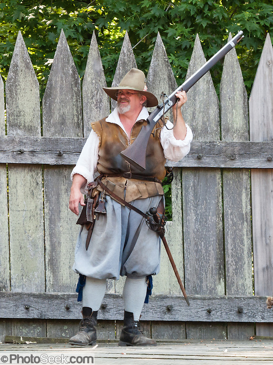"A costumed historical interpreter shows a 1600s matchlock musket at Jamestown Settlement, Virginia, USA. Jamestown Settlement, operated by the state's Jamestown-Yorktown Foundation, chronicles 1600s Virginia and the convergence of Powhatan Indian, European, and west central African cultures. Created as part of the 350th anniversary celebration in 1957 as ""Jamestown Festival Park,"" Jamestown Settlement is adjacent to the complementary ""Historic Jamestowne"" museum (which is on Jamestown Island, is the actual historic and archaeological site where the first settlers lived, and is run by the National Park Service and Preservation Virginia). For licensing options, please inquire."